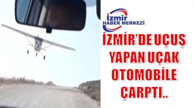 İZMİR'DE UÇUŞ YAPAN UÇAK OTOMOBİLE ÇARPTI