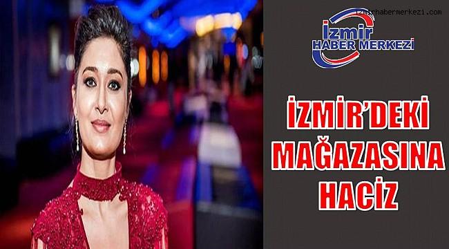 İZMİR'DEKİ MAĞAZASINA HACİZ..